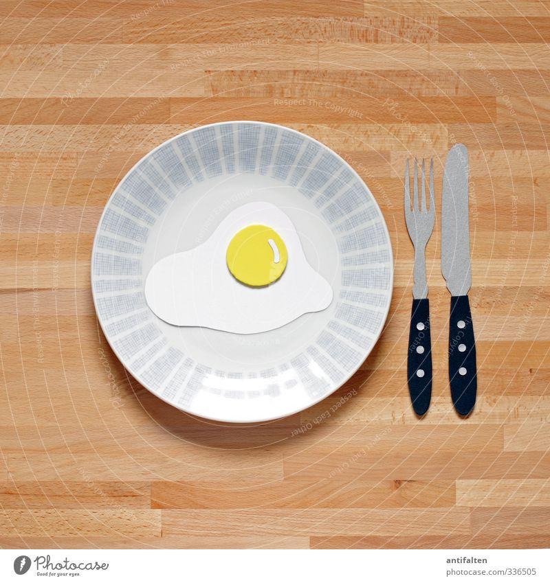 fried egg Food Egg Fried egg sunny-side up Breakfast Lunch Vegetarian diet Crockery Plate Cutlery Knives Fork Paper Wood Glass Plastic Eating Friendliness