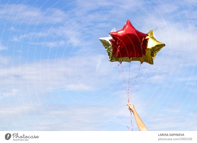 Colorful shiny star-shaped balloons on sky Design Joy Summer Beach Decoration Wallpaper Feasts & Celebrations Wedding Birthday Arm Hand Sky Clouds Balloon