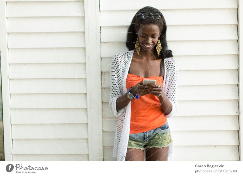 Young african woman with mobile phone Lifestyle Beautiful To talk Telephone PDA Technology Human being Young woman Youth (Young adults) Woman Adults 1