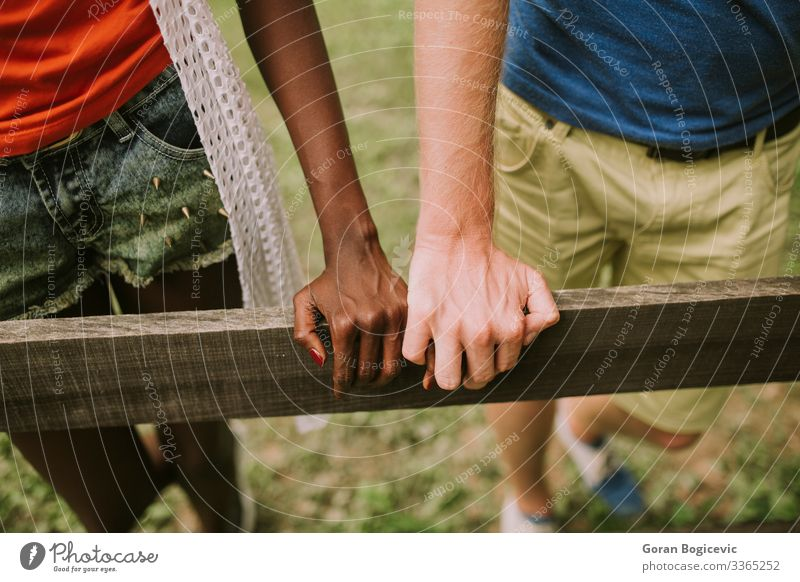 Multiracial couple in the park Lifestyle Summer Human being Woman Adults Man Couple Arm Hand Wood Together Modern Black boyfriend casual Caucasian diversity