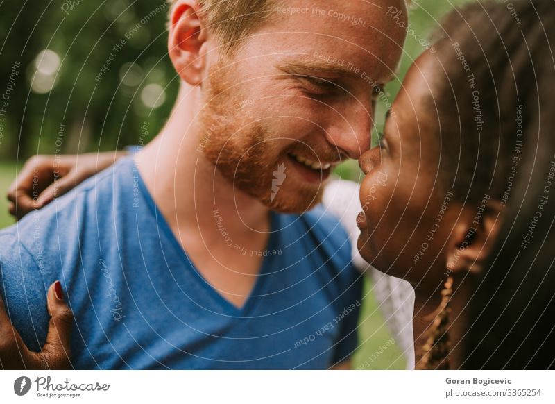 Multiracial couple in the park Lifestyle Summer Human being Woman Adults Man Couple 2 18 - 30 years Youth (Young adults) Red-haired Together Modern Black