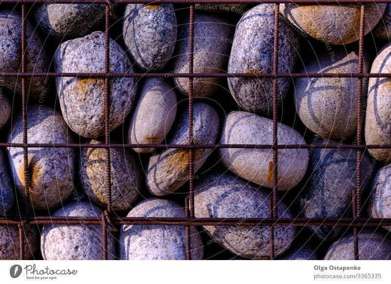 Stone in wire mesh wall Grunge Material Structures and shapes Consistency Construction Wire Wall (barrier) Architecture Rock Surface Abstract Rough Block