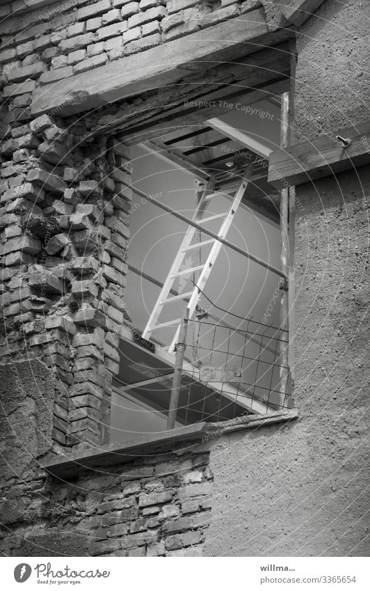 Construction work on the maisonette Scaffold restoration refurbishment Brick construction Scaffolding Ladder Industrial building Construction site Building