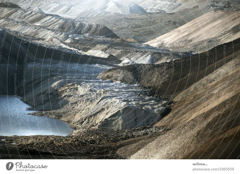 Opencast mining in the Leipzig Neuseenland Landscape Bizarre Sparse Gloomy Interesting Hill Mountain Slagheap Soft coal mining open pit mining Lake