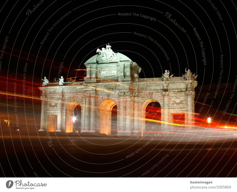 Puerta de Alcala, Madrid, Spain at night. Vacation & Travel Tourism Art Sky Building Architecture Monument Transport Street Car Stone Old Historic Blue Yellow