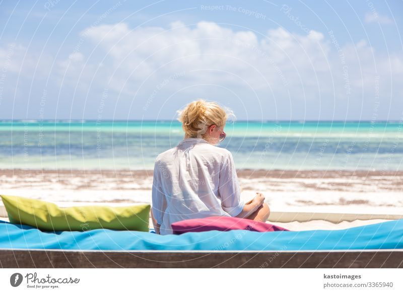 Relaxed woman in luxury lounger enjoying summer vacations. Lifestyle Luxury Joy Happy Beautiful Wellness Relaxation Meditation Leisure and hobbies Reading