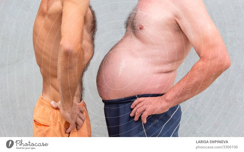 Two naked men comparing belly Diet Beer Lifestyle Body Wellness Sports Success Human being Man Adults Fitness Thin Large Lose overweight Waist fat care health