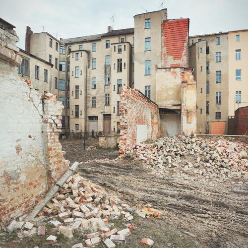 Second Hand Sky Clouds Small Town Downtown Deserted House (Residential Structure) Wall (barrier) Wall (building) Facade Window Old Trashy Gloomy Decline