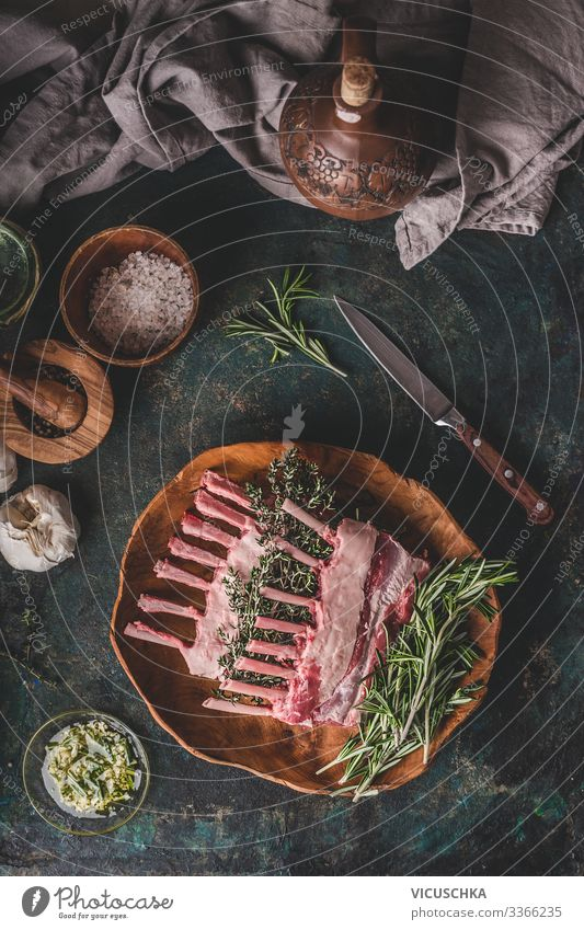 Raw lamb racks with fresh rosemary Food Meat Herbs and spices Cooking oil Nutrition Organic produce Crockery Style Living or residing Restaurant