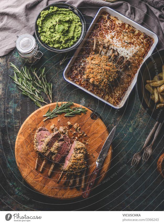Medium rare lamb racks with pea puree Food Meat Nutrition Crockery Style Living or residing Table Restaurant Easter Design Tradition Cooking Gourmet medium rare