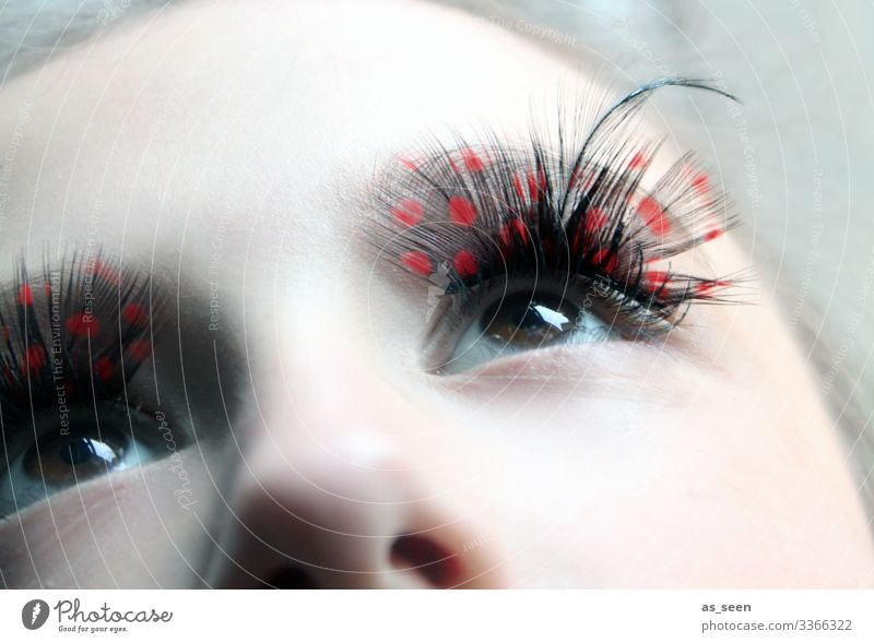 Human being Youth (Young adults) Young woman Beautiful Red Girl Black Eyes Bird Creativity Feather Fantastic Shows Carnival Exotic Cosmetics