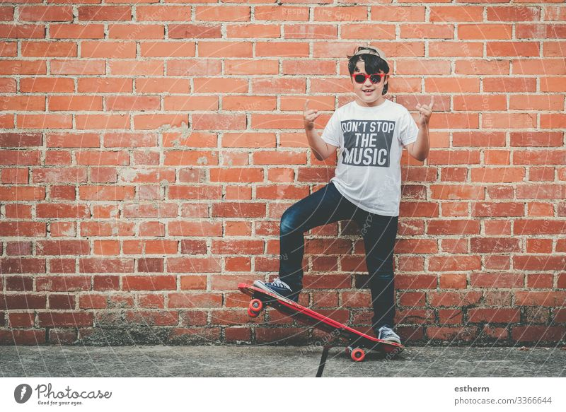 child with skateboard and sunglasses Lifestyle Joy Leisure and hobbies Freedom Summer Music Sports Fitness Sports Training Success Human being Masculine Child
