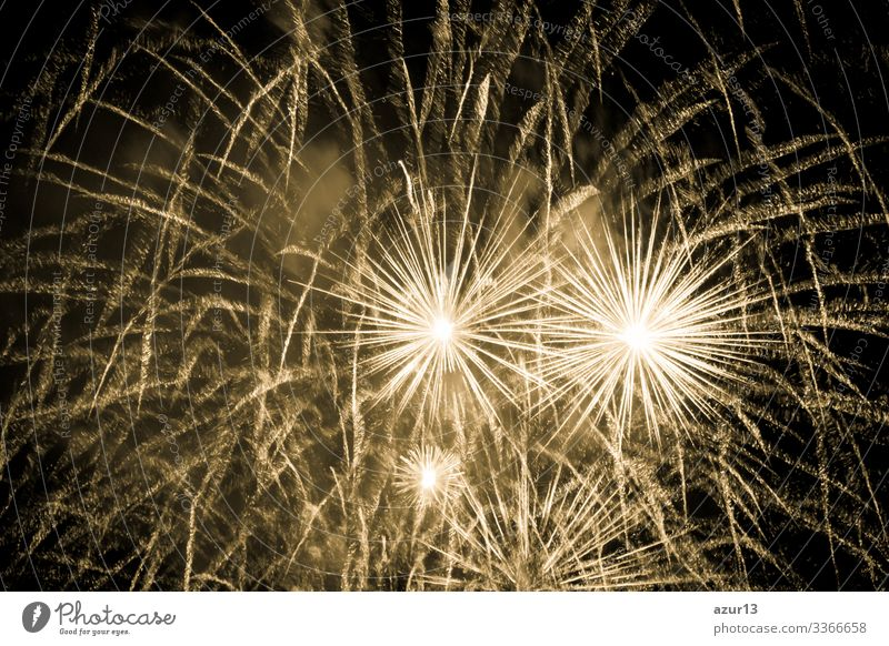 Luxury fireworks event sky show with yellow big bang stars luxury entertainment party festival nightlife pyrotechnics magic celebration celebrate new year