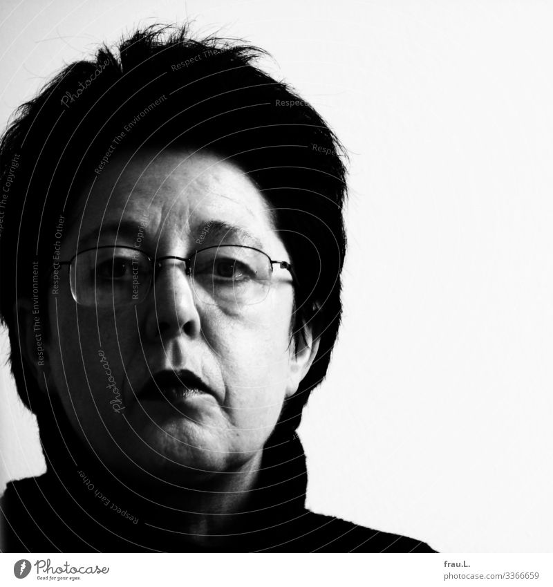 53 Human being Feminine Woman Adults 1 45 - 60 years Eyeglasses Black-haired Short-haired Observe Looking Uniqueness Skeptical Earnest Black & white photo