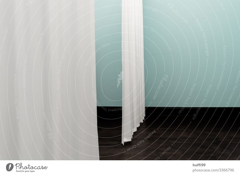 two curtains in the room in front of a turquoise coloured wall Museum Stage Building Wall (barrier) Wall (building) Drape Stage set Esthetic Simple Elegant