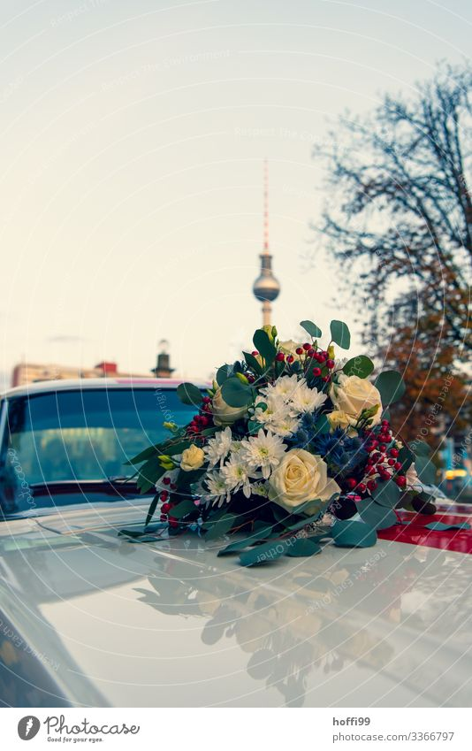Berlin flowers with tower Lifestyle Wedding Cloudless sky Beautiful weather Plant Flower Capital city Landmark Berlin TV Tower Vehicle Vintage car Bouquet