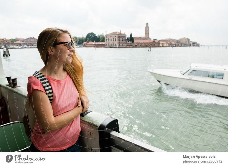 Young female traveler on the tour boat in Venice, Italy Lifestyle Vacation & Travel Tourism Trip Sightseeing City trip Cruise Ocean Feminine Young woman