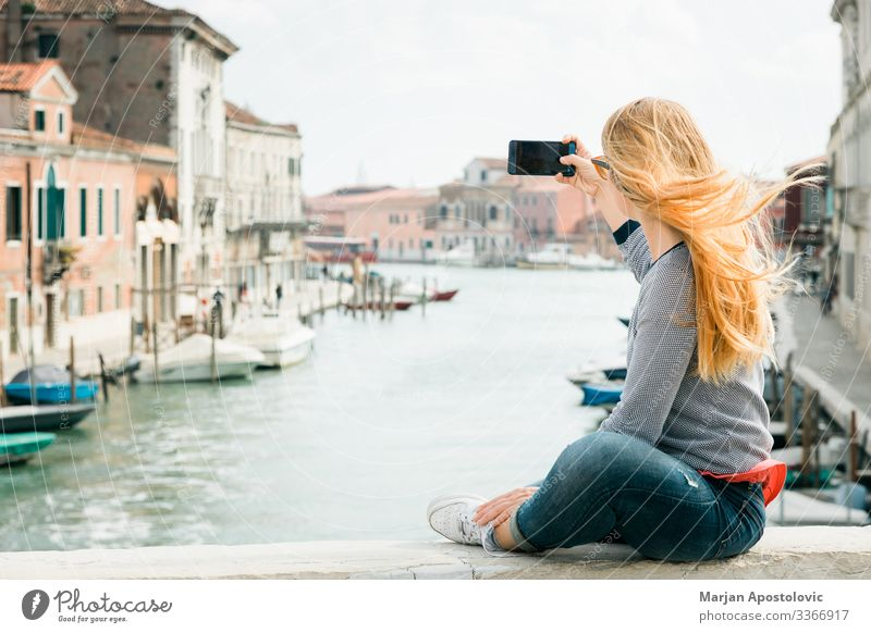 Young woman taking a selfie on the bridge in Venice Lifestyle Vacation & Travel Tourism Trip Sightseeing City trip Cellphone Camera Feminine