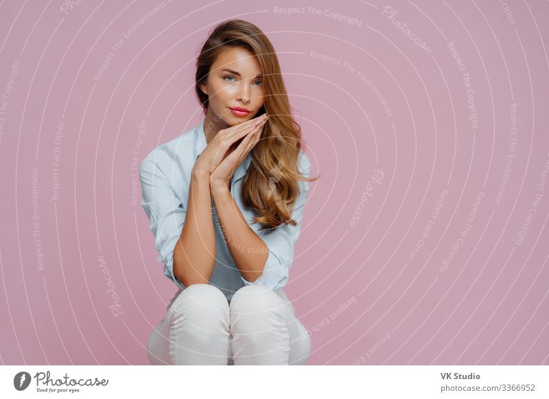 Beautiful woman with long hair, dressed in shirt and trousers Happy Skin Face Cosmetics Make-up Human being Feminine Woman Adults Pants Smiling Sit Stand Fresh