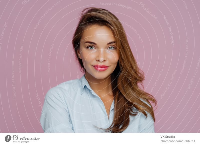 Headshot of lovely European lady Skin Face Cosmetics Make-up Contentment Human being Feminine Woman Adults Lips Hand Shirt Stand Fresh Natural Self-confident