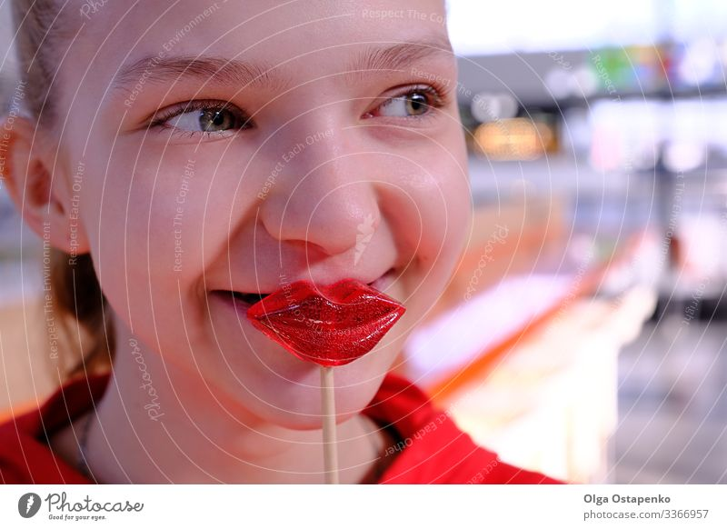 Girl with lollipops in the form of a kiss Heart Beautiful Love Kissing Youth (Young adults) Young woman Red Candy Lollipop Woman Beauty Photography Sweet Happy