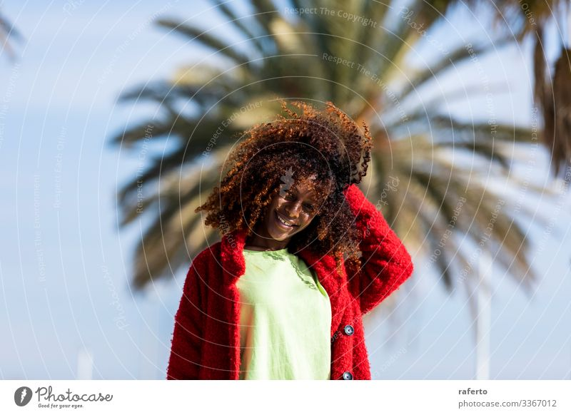 Portrait of a beautiful afro woman standing in the street Lifestyle Happy Beautiful Face Vacation & Travel Human being Feminine Young woman Youth (Young adults)