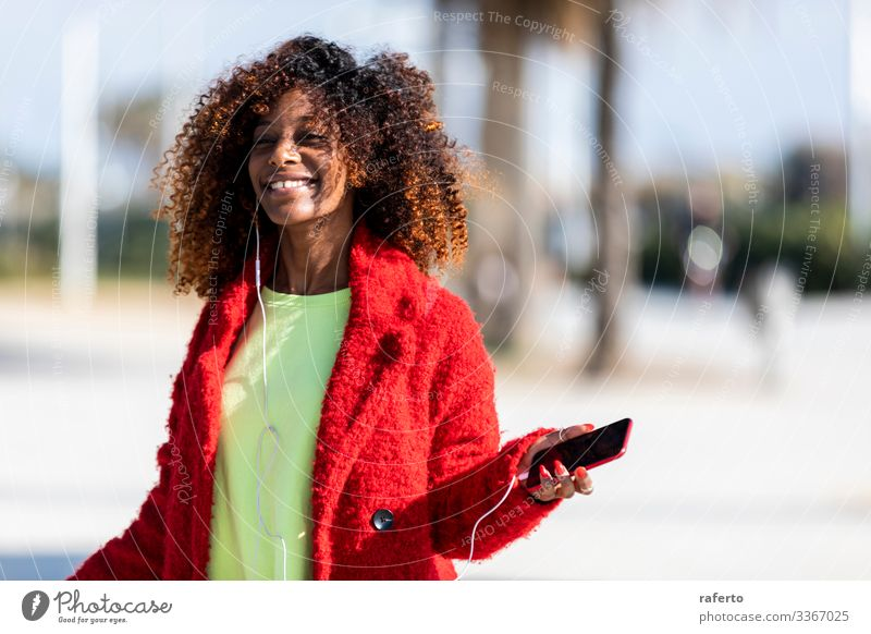 Young afro american woman laughing while dancing outdoors Lifestyle Joy Happy Beautiful Face Human being Feminine Young woman Youth (Young adults) Woman Adults