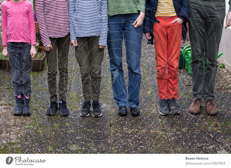 family constellation people group Legs Stand to attention colored variegated Funny in common variation Multicoloured Exterior shot Leisure and hobbies free time