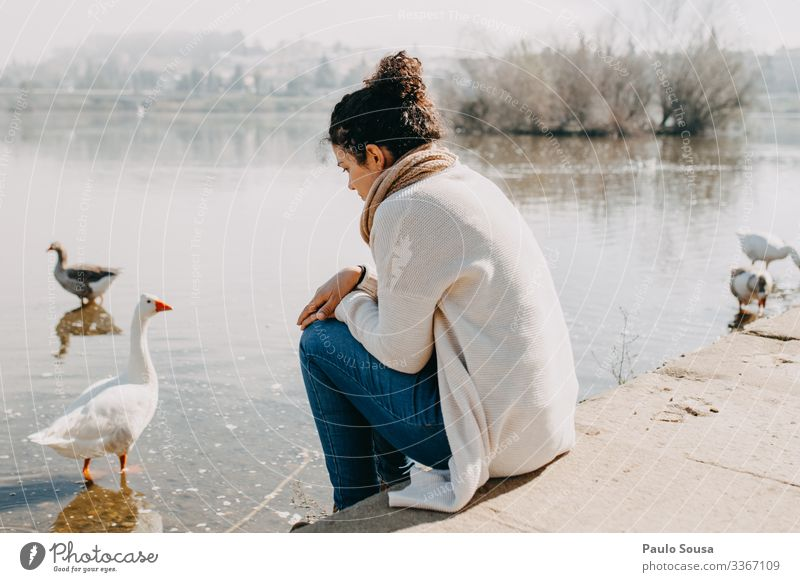 Woman thinking by the river Human being Vacation & Travel Nature Youth (Young adults) Loneliness Calm 18 - 30 years Lifestyle Adults Environment Sadness