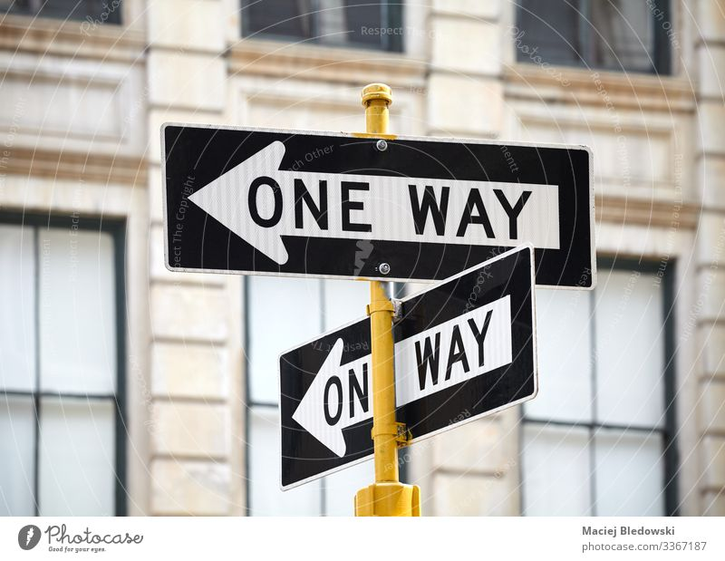 One way street signs in New York City. Vacation & Travel Sightseeing City trip Town Downtown Building Transport Road traffic Street Road sign Arrow Advice