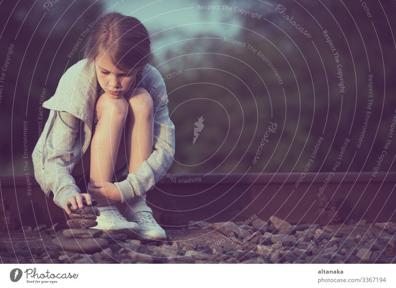 Portrait of young sad girl sitting outdoors on the railway Face Child Human being Woman Adults Family & Relations Infancy Think Sadness Emotions Concern Grief