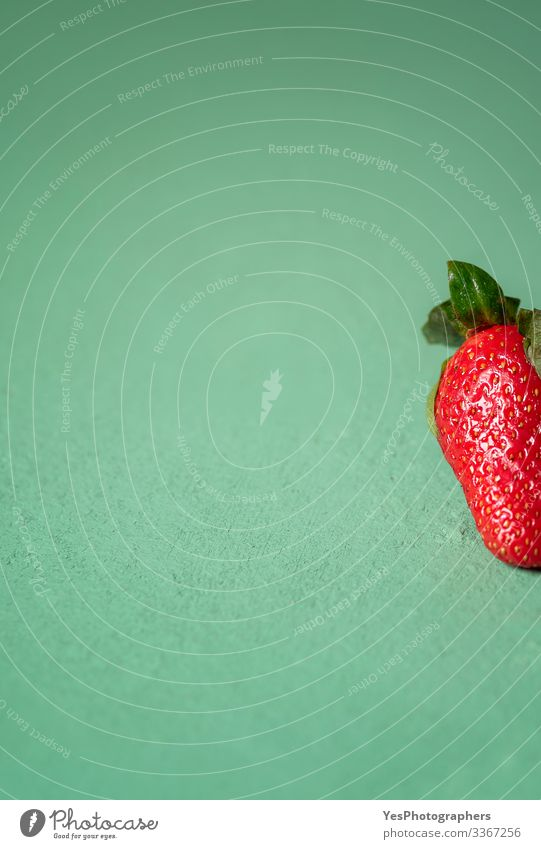 One strawberry on green table. Part of a strawberry close-up Fruit Dessert Organic produce Vegetarian diet Diet Fresh Natural Cute Sweet Green Red agriculture