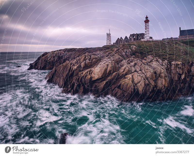 Lighthouse on Breton rocky coast with waves and sea Wide angle Exterior shot Colour photo Idyll Horizon Hope Wanderlust Homesickness Calm White Brown Blue