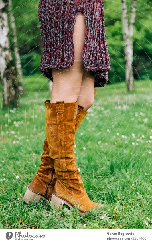 Young woman in knitted dress in the park Lifestyle Style Beautiful Summer Human being Youth (Young adults) Woman Adults Legs 1 18 - 30 years Autumn Park Fashion