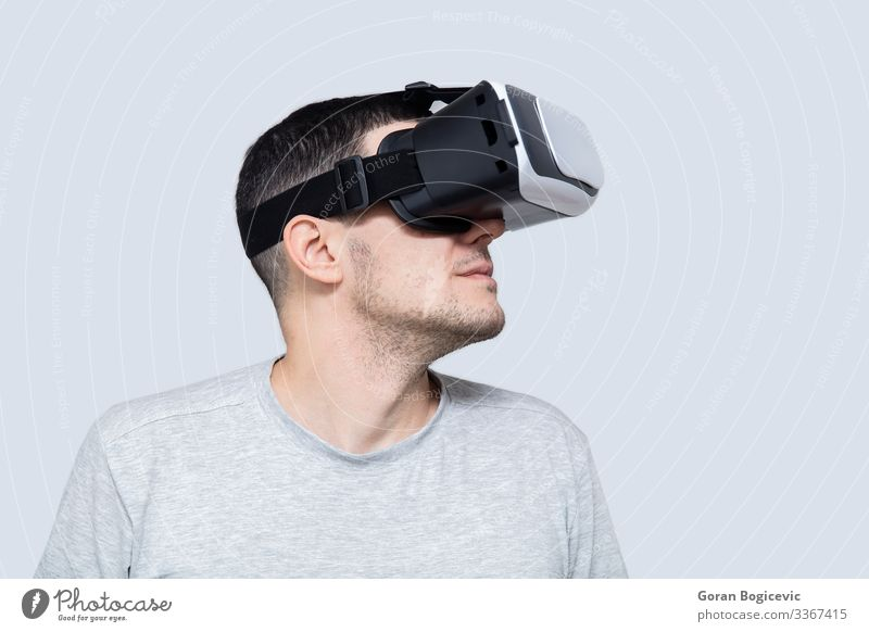 Young man using vr headset, experiencing virtual reality Leisure and hobbies Playing Entertainment Headset Technology Human being Youth (Young adults) Man