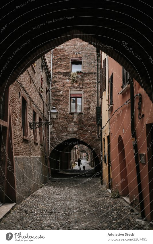 Arch opening passage to narrow street in city old arch house architecture travel stone building town traditional destination urban culture scene typical