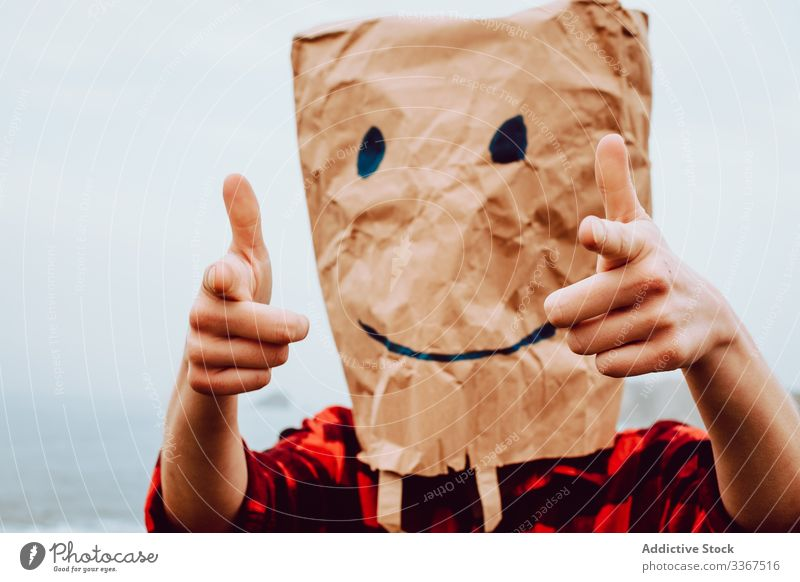 Person with paper bag on head pointing at camera plastic package ecology concept environment person gesture sign nature pollution problem packet polyethylene