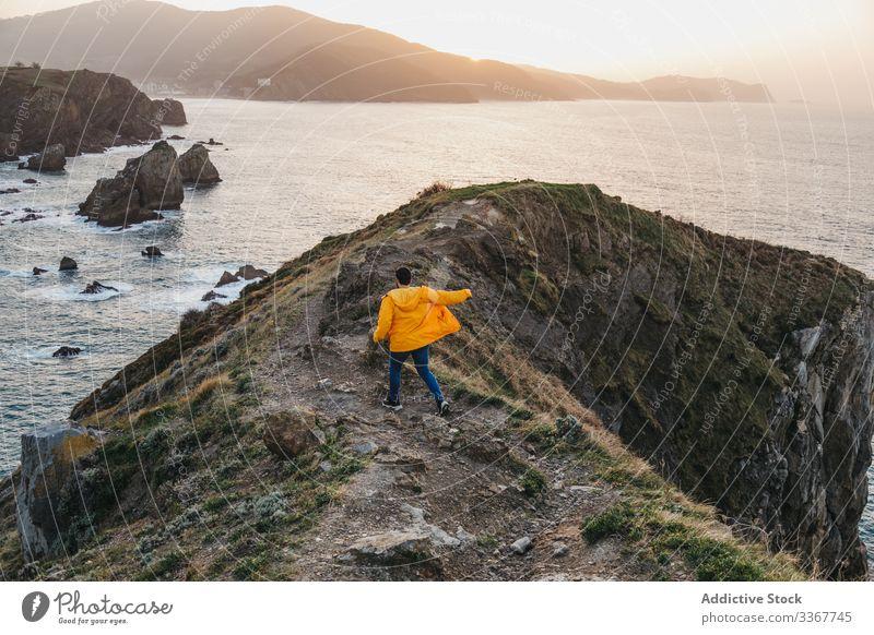 Tourist walking on hill and contemplating wonderful landscape man tourism sea ocean shore coast mountain vacation journey spain travel wanderlust seascape