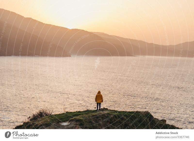 Tourist standing on hill and contemplating wonderful landscape man tourism sea ocean shore coast mountain vacation journey spain water trip travel wanderlust