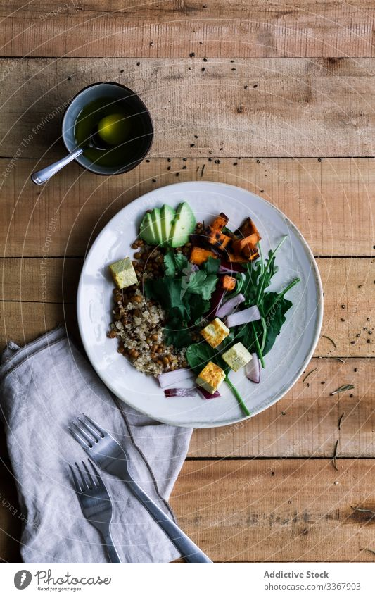 Delicious vegetable dish in plates on table delicious vegetarian different rice rustic food meal wooden lunch dinner gourmet healthy tasty cuisine fresh