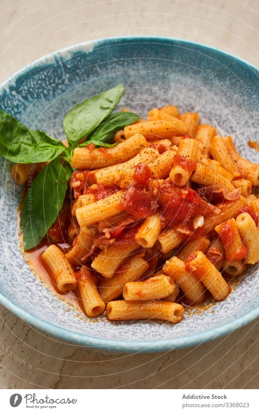 Tasty pasta with herbs and tomato macaroni noodles cheese plate bowl table served setting italian food traditional perfect restaurant dish sauce style elegant
