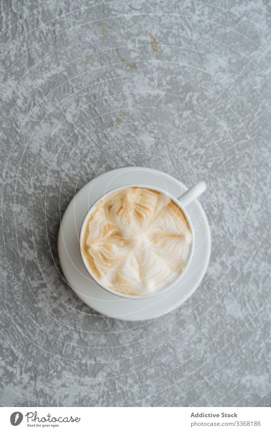 Cup of cappuccino on grey textured background coffee cup art latte drink hot beverage saucer froth foam breakfast cafe morning caffeine aroma flavor gourmet
