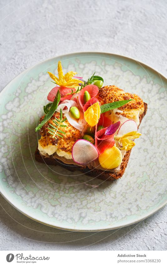 Exquisite sandwich with vegetables and flowers cafe plate herb decor exquisite food lunch meal tropical exotic restaurant service snack cuisine healthy dinner