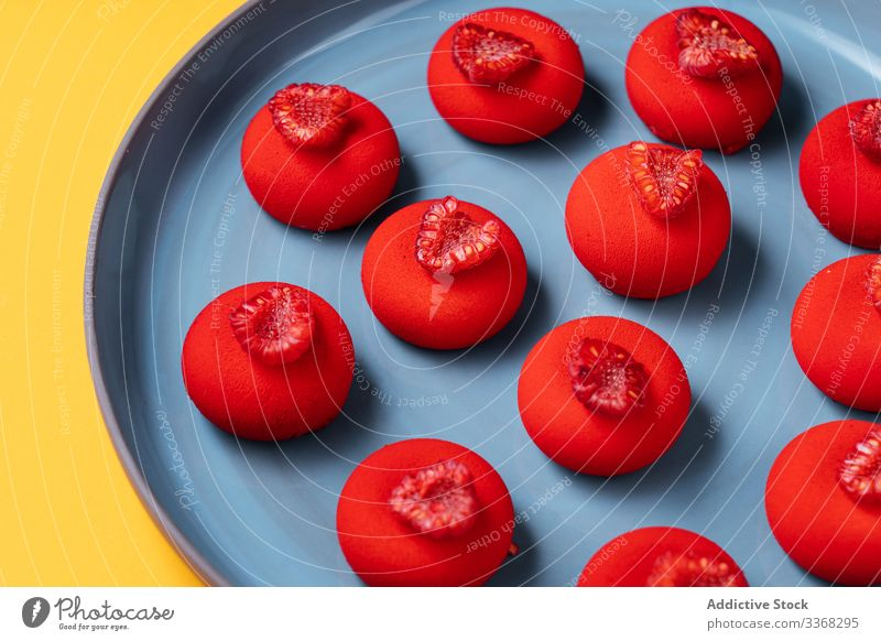 Bright red dessert on plate raspberry ball sweet food pastry colorful bright tasty cuisine dish delicious yummy scrumptious sugar calorie portion baked gourmet