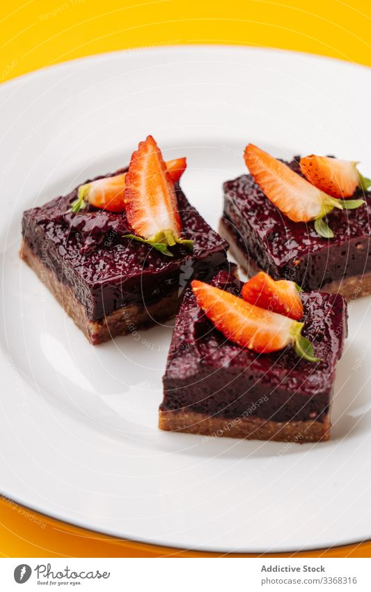 Pieces of berry and chocolate cake dessert sweet plate strawberry piece food pastry tasty cuisine dish delicious yummy scrumptious sugar calorie portion baked