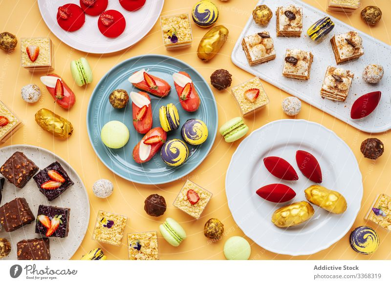 Various yummy desserts on plates sweet assortment food pastry tasty cuisine dish delicious scrumptious sugar calorie portion piece baked gourmet prepared cookie