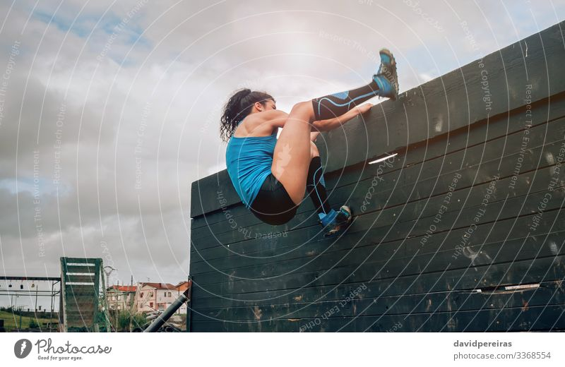 Female in obstacle course climbing wall Lifestyle Sports Climbing Mountaineering Human being Woman Adults Sneakers Authentic Strong Loneliness Effort Energy