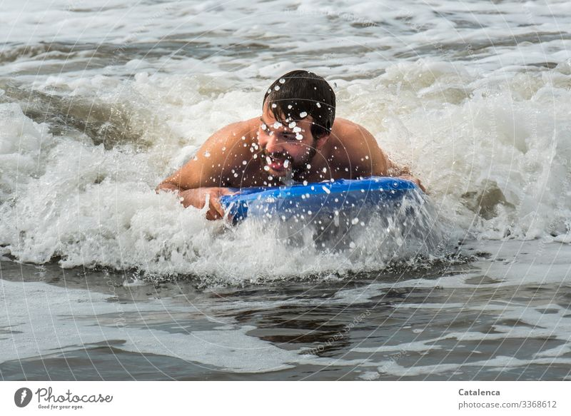 Fun bathing in the sea person masculine Young man bathe be afloat surf board Ocean Surf White crest fun Wet Beach Summer Blue Gray Joy holidays Water