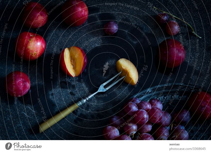 Nectarine with fork and red grapes on black background Bunch of grapes Fruit Nutrition Organic produce Vegetarian diet Diet Fork Tray Healthy Eating Food