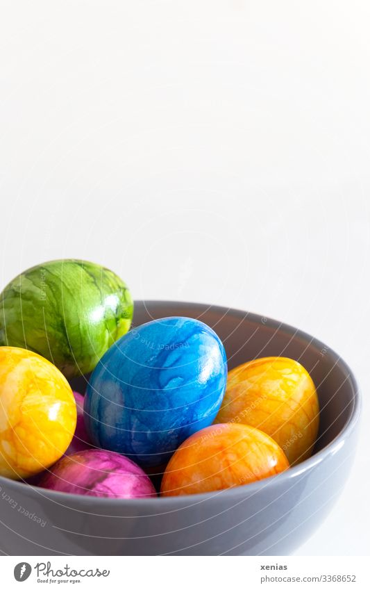 colourful easter eggs in a grey bowl against a white background Easter eggs Food Egg Nutrition Breakfast Buffet Brunch Organic produce Vegetarian diet Fasting